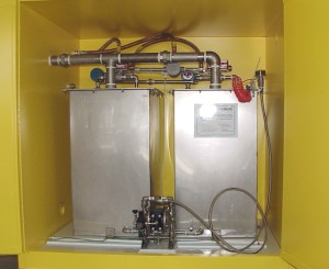 Two-tank solvent collection system in fireproof cabinet